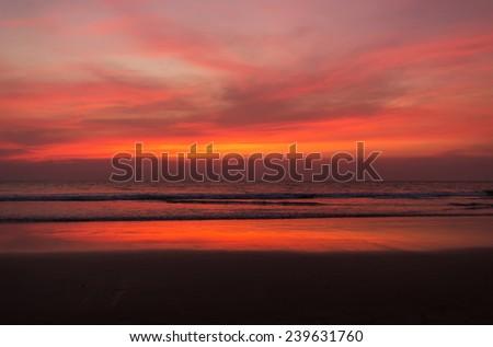 sunset on Goa sand beach - stock photo