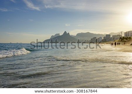 Sunset on Ipanema beach in Rio de Janeiro with the Leblon beach, hill Two Brothers and Stone Gavea at the bottom - stock photo