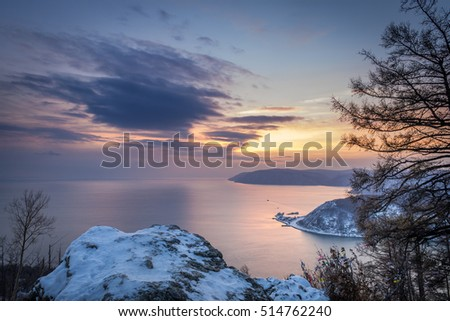 sunset on lake Baikal, Listvyanka, Chersky stone, the Angara