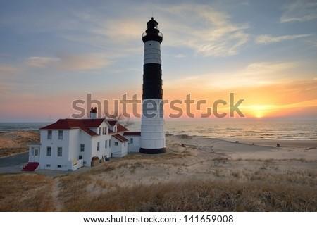 Sunset on Lake Michigan Big Sable Point Lighthouse. USA - stock photo