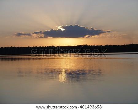 Sunset on Lake Sandoval, Puerto Maldonado Region, Peru - stock photo