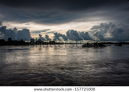 Sunset on Mekong river, Laos - stock photo