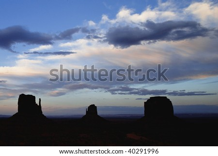Sunset on Monument Valley Butte Formations better known as the Mittens Monument Valley Navajo Tribal Park Utah Arizona