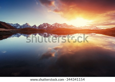 Sunset on mountain lake Koruldi. Upper Svaneti, Georgia, Europe. Caucasus mountains. - stock photo