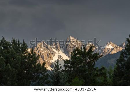 Sunset on mountaintop in the alps - Tirol Austria - stock photo