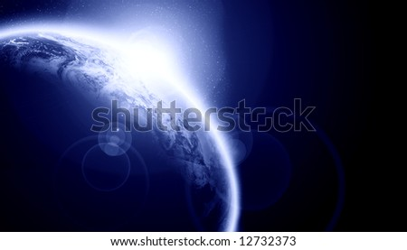 Sunset on planet earth on a dark background with room for copy