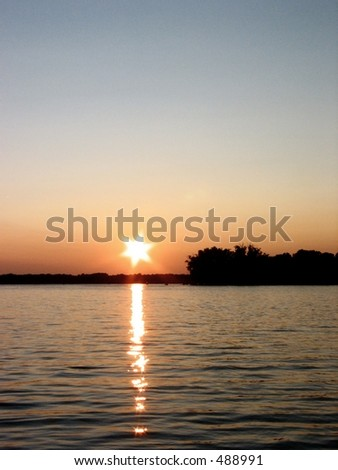 Sunset on Reed's Lake - stock photo