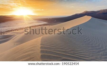 Sunset on sand dune Eureka, Death Valley, California - stock photo