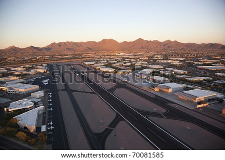 Sunset on Scottsdale Airport and the McDowell Mountains - stock photo