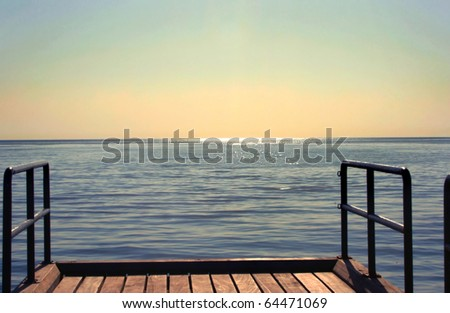 Sunset on sea, view from the bridge. - stock photo