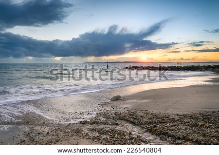 Sunset on Solent Beach at Southbourne in Bournemouth, Dorset - stock photo