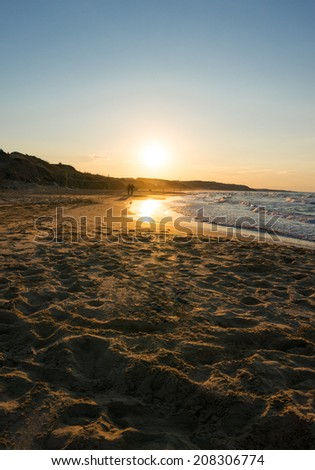 sunset on the beach - stock photo