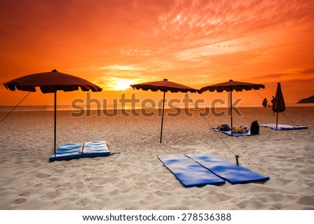 sunset on the beach. - stock photo