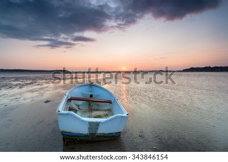Sunset on the beach at Sandbanks in Poole, Dorset - stock photo