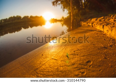 sunset on the beach fishing lake landscape river sun sets Sunrise Russia close - stock photo
