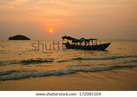 Sunset on the beach in Sihanoukville, Cambodia - stock photo