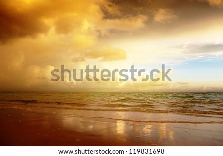 sunset on the beach of caribbean sea - stock photo