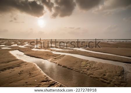 Sunset on the beach of Domburg, Zeeland, The Netherlands - stock photo