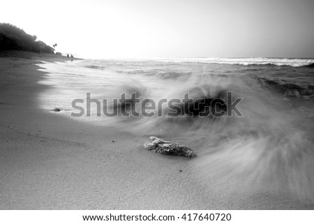 Sunset on the beach of Kukup, Yogyakarta with various pattern of motion blur waves. Nature composition,grain and noise effect,soft focus and vibrant colours.
