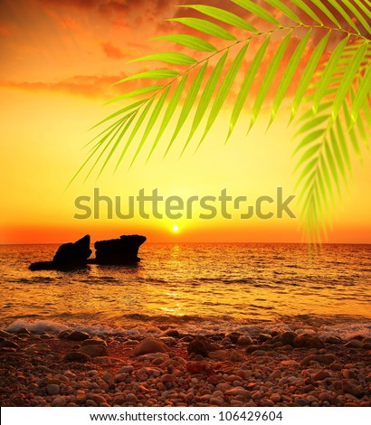 Sunset on the beach, peaceful summer landscape background, beautiful sea view, bright sun shining and calm sea, deep ocean waters, vacation and travel destination - stock photo