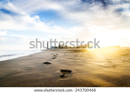 Sunset on the beach. The footprints. Canary islands, Maspalomas.