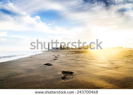 Sunset on the beach. The footprints. Canary islands, Maspalomas. - stock photo
