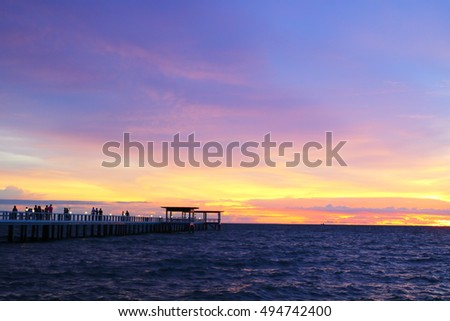 Sunset on the beach with beautiful sky at port