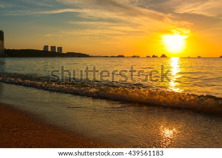 Sunset on the beach with beautiful sky in Pattaya, Thailand