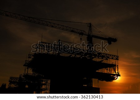 Sunset on the building under construction.