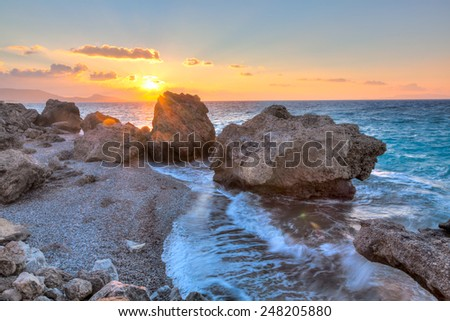 Sunset on the coast at Rhodes Greece Europe - stock photo
