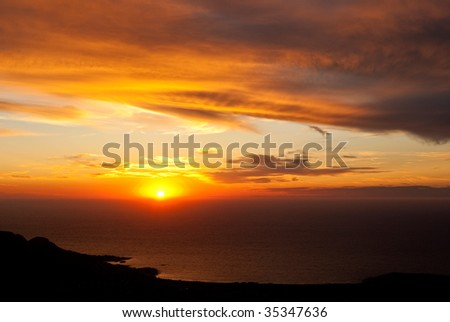 sunset on the corsican coast in France - stock photo