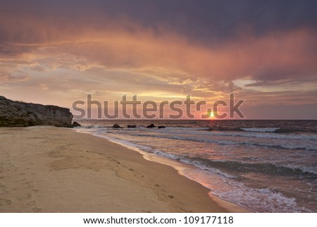sunset on the deserted beach in the Crimea - stock photo