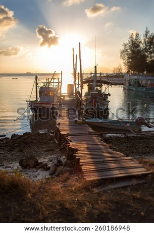 sunset on the dock. photo scenic sunset on the background of the - stock photo