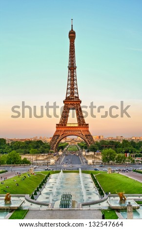 Sunset on the Eiffel Tower, Paris, France. Eiffel Tower at dusk, Paris, France.  Atardecer en la Torre Eiffel, Paris, Francia. Tower Eiffel at dusk, Paris, France. - stock photo