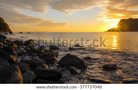 Sunset on the famous Isle of Skye in Scotland - stock photo