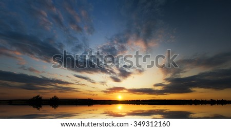 Sunset on the forest  lake - stock photo