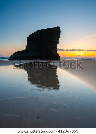 Sunset on the golden sandy beach at Bedruthan Steps Cornwall England UK Europe