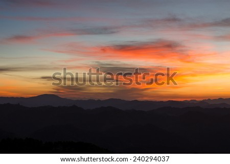 Sunset on the horizon in a peaceful valley, Chiang Mai, Thailand.