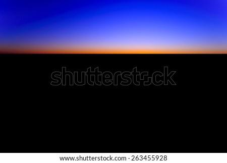 Sunset on the horizon in outback australia - stock photo
