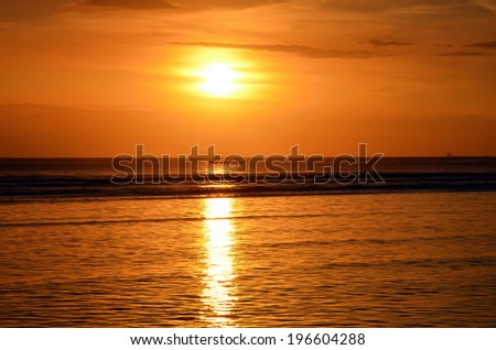 Sunset on the island of Gili Trawangan, Indonesia. Fishing boat returns at sunset - stock photo
