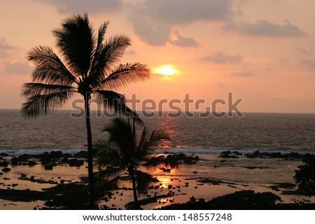 Sunset on the Keauhou, Hawaii coast. - stock photo