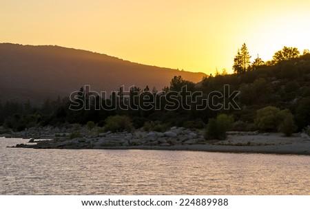 Sunset on the lake. - stock photo
