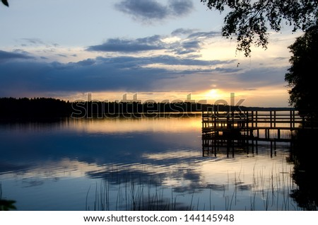 Sunset on the lake. Finland. - stock photo