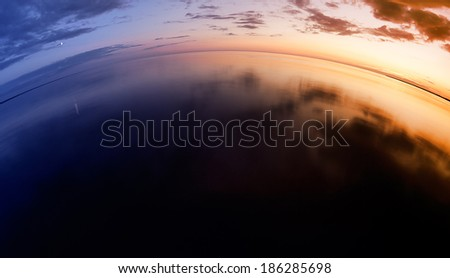 Sunset on the lake, fisheye lens - stock photo