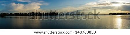 Sunset on the lake(panorama) - stock photo