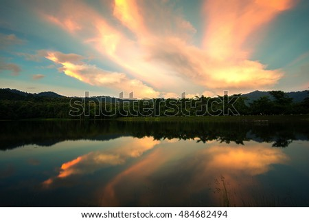 Sunset on the lake , reflection of cloud , thailand.