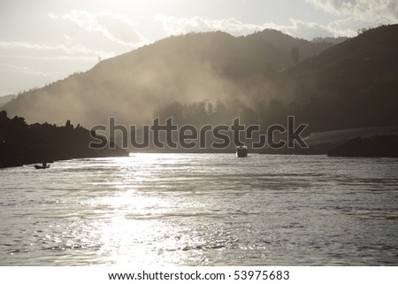 Sunset on the mekong river, Laos - stock photo