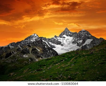 sunset on the Ober Gabelhorn - Swiss Alps - stock photo