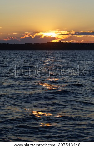 Sunset on the ocean. - stock photo