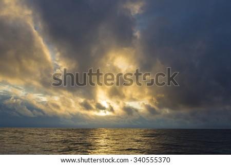 Sunset on the ocean in the Galapagos Islands. Ecuador 2015 - stock photo